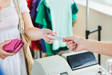 shoppers: Close-up of a caucasian woman paying with her credit card