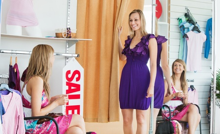 choosing clothes: Delighted women choosing clothes together
