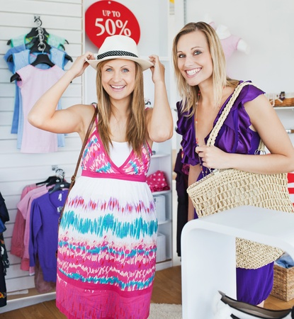 Relaxed women choosing clothes together photo