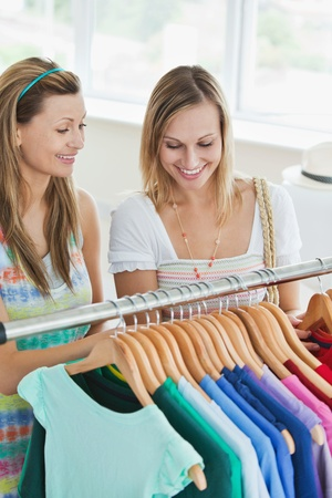 Caucasian women choosing clothes together photo