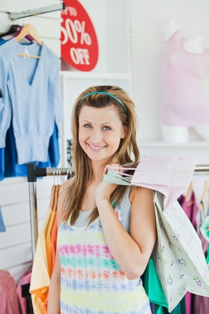 Smiling woman choosing clothes  photo