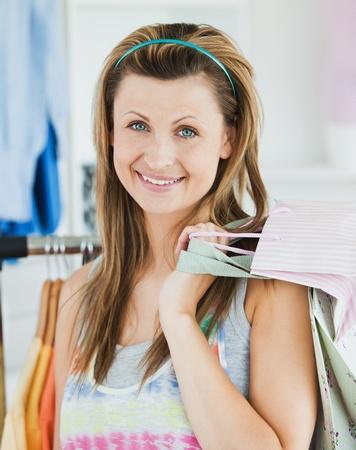 choosing clothes: Happy woman choosing clothes