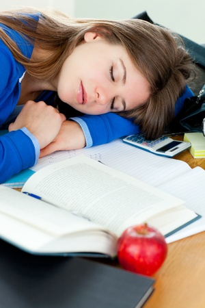 Attractive girl sleeping at her desk photo