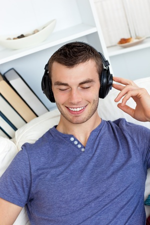 Relaxed man listening to music photo