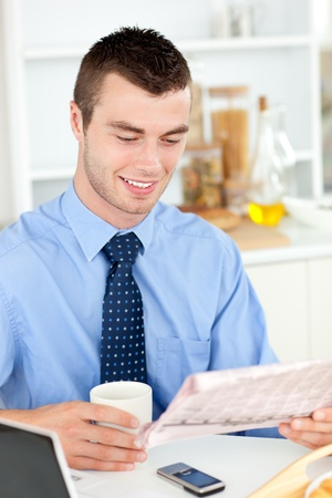 Good-looking man reading a book Stock Photo - 10250117
