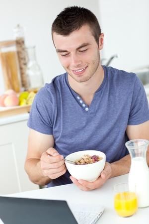 Happy man having breakfast Stock Photo - 10249720
