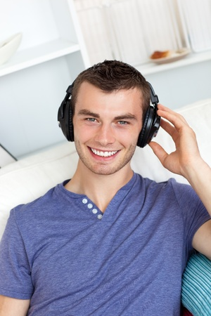 Laughing man listening to music photo