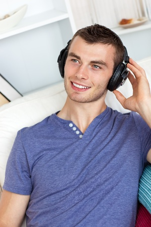 Good-looking man listening to music photo