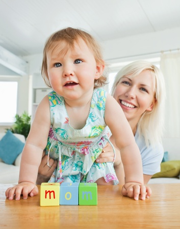 Radiant mother playing with her daughter Stock Photo - 10250190