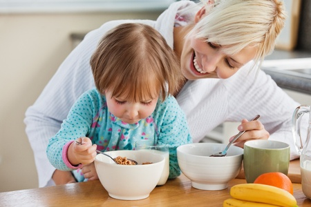 Mother and daughter having breakfast photo