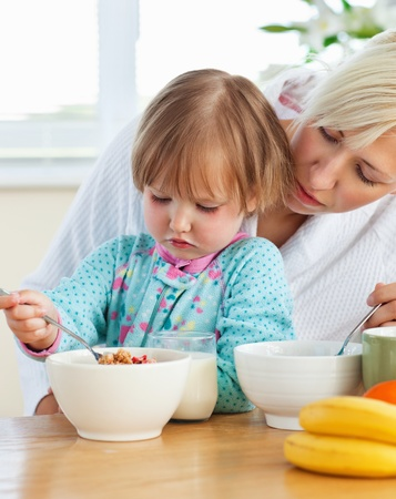 Helping mother and daughter having breakfast Stock Photo - 10248168