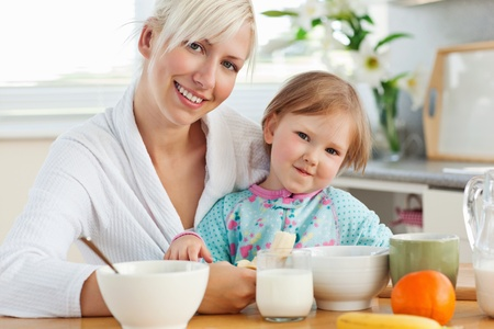 Radiant mother and daughter having breakfast photo