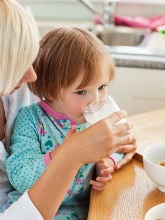 Beauty mother and daughter having breakfast Stock Photo - 10248916