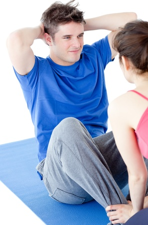 aerobatics: Young man doing fitness exercises with a woman