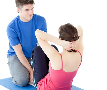 Attractive man doing fitness exercises with a woman photo