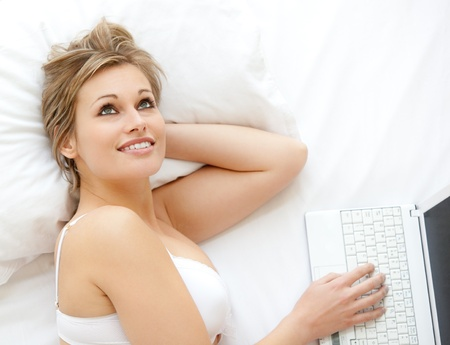 convivial: Blond woman in front of her laptop