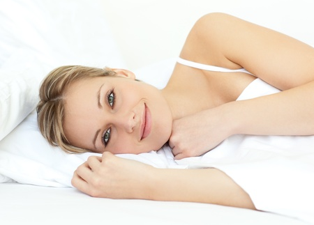 enjoyable: Relaxed woman lying in bed
