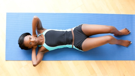 free weight: Musular woman doing fitness