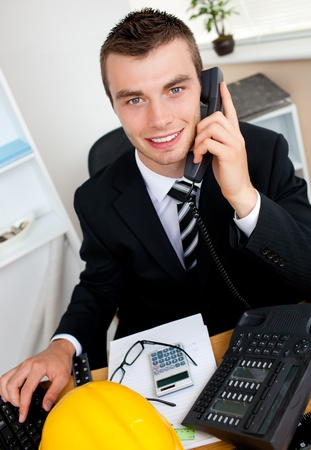 conference call: Handsome businessman using phone