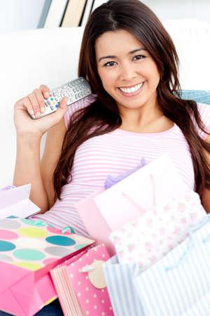 Smiling woman watching TV photo