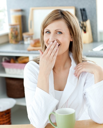 Yawning woman with a cup  photo