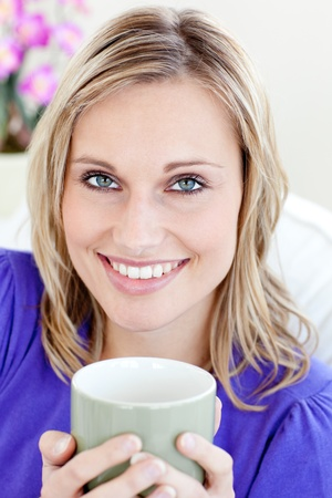 Glowing woman holding cup photo