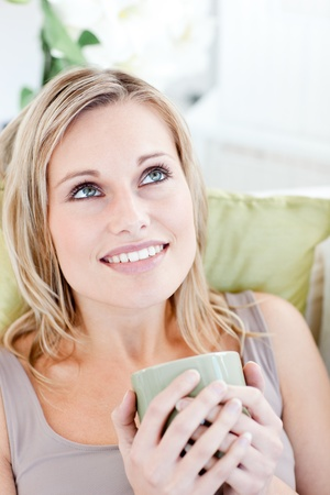 Charming woman holding cup of coffee photo