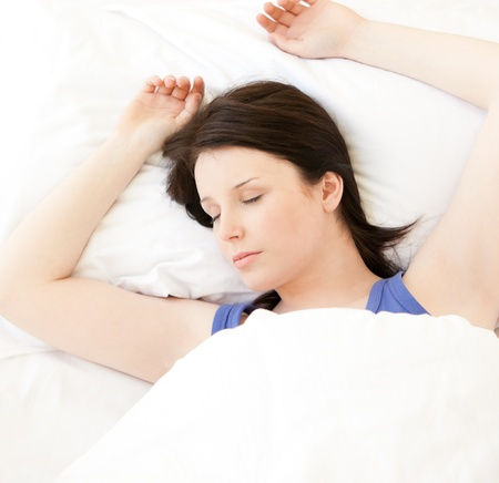 Cute young woman sleeping in her bed  photo