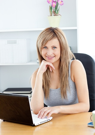 Elegant woman using her laptop at home Stock Photo - 10248538