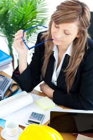 Busy businesswoman sitting a her desk photo