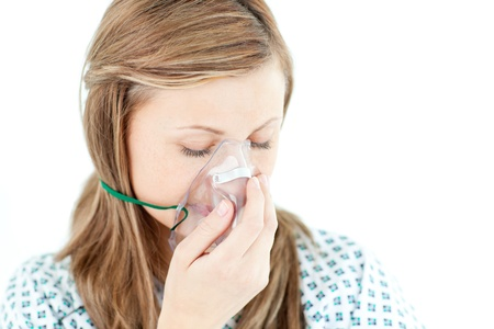inhale: Depressed female patient with a mask Stock Photo