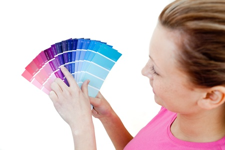 Caucasian woman choosing colours in her living-room photo