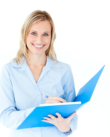 Charming businesswoman holding a folder smiling at camera photo