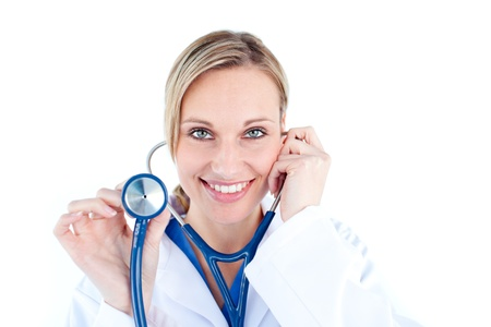Pretty young female doctor holding a stethoscope photo