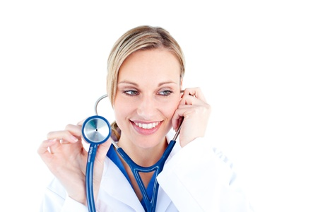 Radiant young female doctor holding a stethoscope photo