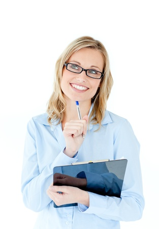 Pensive businesswoman holding a clipboard Stock Photo - 10250087