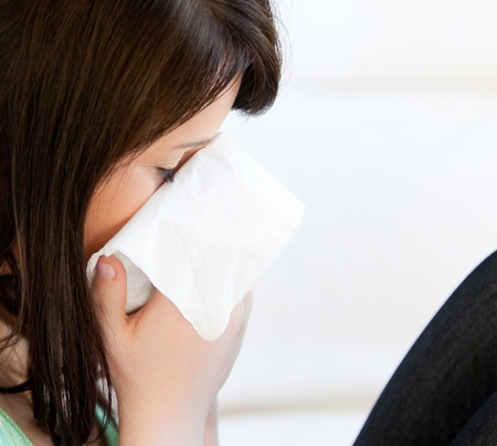 Diseased female teenager with tissues  photo