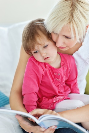 Mother and daughter reading a book Stock Photo - 10250450