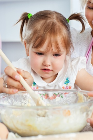 Relaxed woman baking cookies with her daughter Stock Photo - 10250015