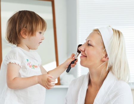 Beaming mother taking care of her child Stock Photo - 10250164