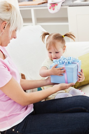Woman getting a present from her daughter photo
