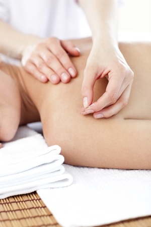Close-up of a young woman receiving a acupuncture treatment Stock Photo - 10246444