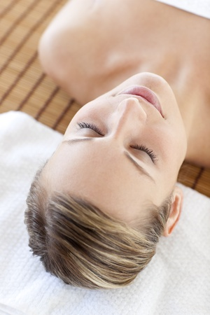 Portrait of a beautiful young woman lying on a massage table Stock Photo - 10250348