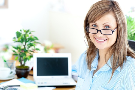 Blond businesswoman smiling at the camera  photo