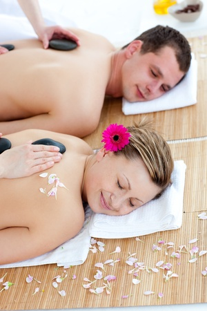 couples therapy: Young couple enjoying a back massage with stone