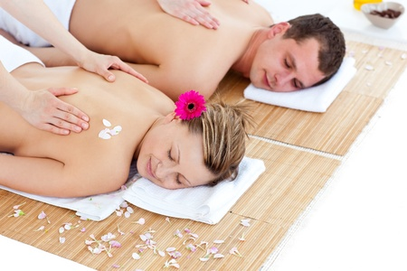 Beautiful young couple receiving a back massage photo