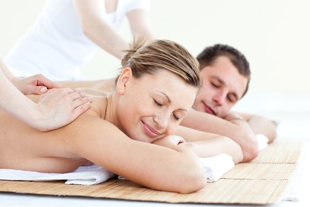 couples therapy: Affectionate couple having a back massage with closed eyes