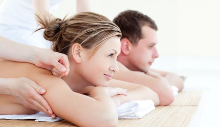 Attractive young couple having an acupunctre therapy Stock Photo - 10247581