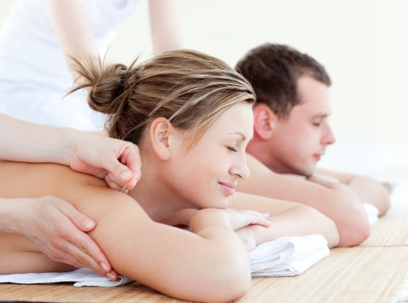 Loving couple having an acupunctre therapy photo