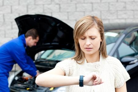 Man repairing car of pretty woman Stock Photo - 10250357